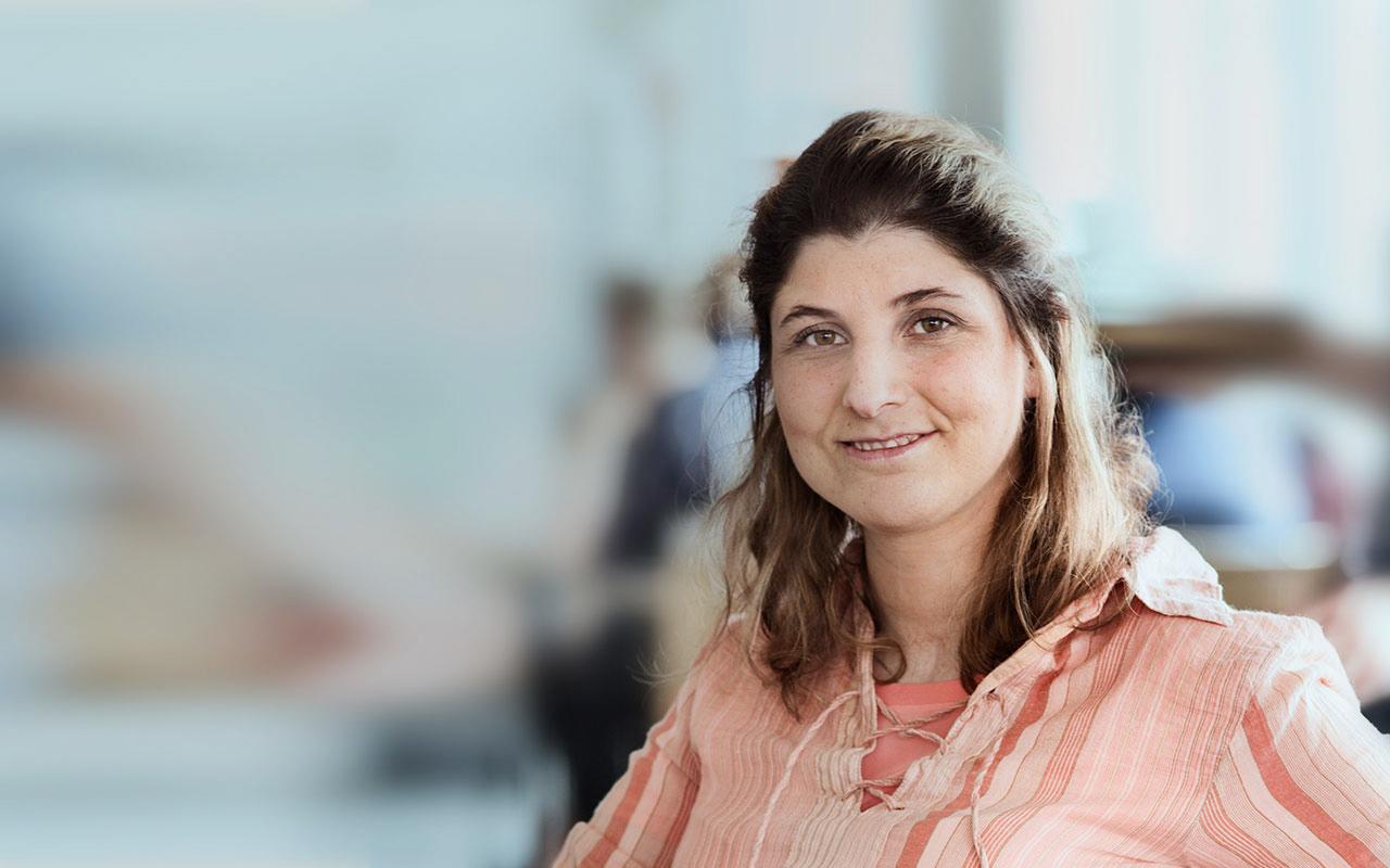 female catheter user in pink shirt smiling